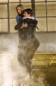 """Ethan Hunt (Tom Cruise, left) with the most important woman in his life, Julia (Michelle Monaghan, right), in """"Mission: Impossible III."""""""
