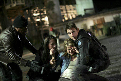 "Ethan Hunt (Tom Cruise, right) never leaves an IMF team member behind: with Luther (Ving Rhames, left) and Zhen (Maggie Q, center left), he assists Lindsey (Keri Russell, center right) in ""Mission: Impossible III."""