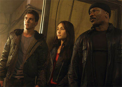 "A new IMF team - Declan (Jonathan Rhys Meyers, left), Zhen (Maggie Q, center), and Luther (Ving Rhames, right) - in ""Mission: Impossible III."" - Large"