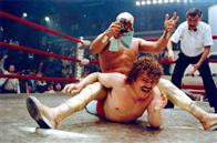 "In ""Nacho Libre""  Ignacio (Jack Black, left), the cook at a monastery, moonlights as a Lucha Libre wrestler to raise money for orphans.  He earns the right to take on Ramses (Cesar Gonzalez 'Bronco,' top), the top local wrestler."