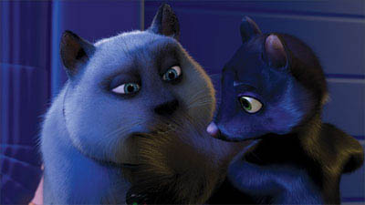 The mischievous raccoon RJ (BRUCE WILLIS) introduces Hammy (STEVE CARELL) to the wonders of sugar, fat, cholesterol and preservatives that can be found in a box of cookies in DreamWorks Animation's comedy OVER THE HEDGE. - Large