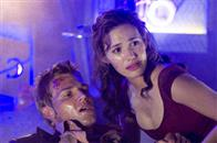 "MIKE VOGEL as Christian and EMMY ROSSUM as Jennifer Ramsey in Warner Bros. Pictures' and Virtual Studios' action adventure ""Poseidon."""