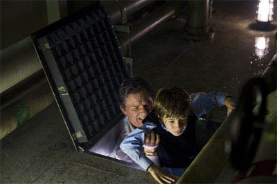 """KURT RUSSELL as Robert Ramsey and JIMMY BENNETT as Conor James in Warner Bros. Pictures' and Virtual Studios' action adventure """"Poseidon.""""  - Large"""
