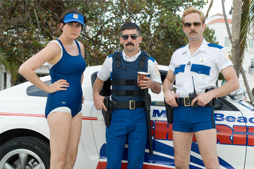Reno's finest – Dep. Trudy Wiegel (Kerri Kenney-Silver, left), Dep. Travis Junior (Robert Ben Garant) and Lt. Jim Dangle (Thomas Lennon) – prepare to save the City of Miami from all kinds of evildoers.  - Large