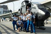 The brave men and women of Reno Sheriff's Department, on special assignment in Miami, pose in front of their newest law enforcement tool: a fully-equipped gunship. From left: Deputy Raineesha Williams (Niecy Nash), Lt. Jim Dangle (Thomas Lennon), Deputy Trudy Wiegel (Kerri Kenney-Silver), Deputy Cherisha Kimball (Mary Birdsong), Deputy Clementine Johnson (Wendi McLendon-Covey), Deputy James Garcia (Carlos Alazraqui, in helicopter), Deputy S. Jones (Cedric Yarbrough), and Deputy Travis Junior (Robert Ben Garant).