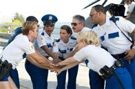 The Reno Sheriffs pump themselves up as they get ready to rid Miami of criminal activity. From left: Lt. Dangle (Thomas Lennon), Travis Junior (Robert Ben Garant), Raineesha Williams (Niecy Nash), Cherisha Kimball (Mary Birdsong), James Garcia (Carlos Alazraqui), S. Jones (Cedric Yarbrough) and Clementine Johnson (Wendi McLendon-Covey), and in the helicopter Deputy Trudy Wiegel (Kerri Kenney-Silver).