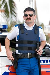 Dep. Travis Junior (Robert Ben Garant) is all business as he prepares to battle evildoers in Miami.