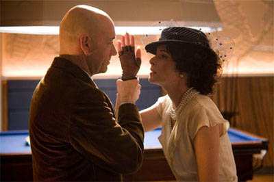 Lex Luthor (KEVIN SPACEY) and Kitty Kowolski (PARKER POSEY) in a scene from Warner Bros. Pictures' and Legendary Pictures' action adventure, <i>Superman Returns</i>. - Large