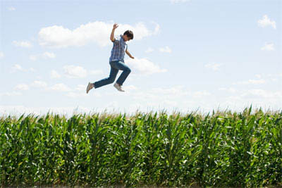 15-year-old Clark Kent (STEPHAN BENDER) leaps above the cornfields in a scene from Warner Bros. Pictures' and Legendary Pictures' action adventure Superman Returns.  - Large
