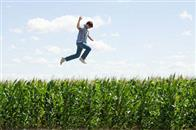 15-year-old Clark Kent (STEPHAN BENDER) leaps above the cornfields in a scene from Warner Bros. Pictures' and Legendary Pictures' action adventure Superman Returns.