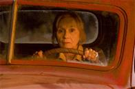 Martha Kent (EVA MARIE SAINT) investigates a fiery crash not far from the Kent Farm in Warner Bros. Pictures' and Legendary Pictures' action adventure Superman Returns.