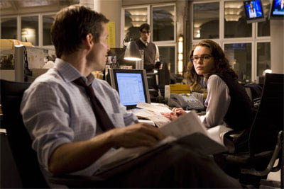 Richard White (JAMES MARSDEN, left) and Lois Lane (KATE BOSWORTH), contemplate the return of Daily Planet reporter Clark Kent (BRANDON ROUTH, in background) in Warner Bros. Pictures' and Legendary Pictures' action adventure Superman Returns.  - Large