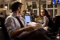 Richard White (JAMES MARSDEN, left) and Lois Lane (KATE BOSWORTH), contemplate the return of Daily Planet reporter Clark Kent (BRANDON ROUTH, in background) in Warner Bros. Pictures' and Legendary Pictures' action adventure Superman Returns.