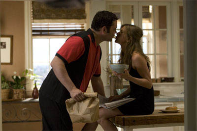 "Bus tour guide Gary Grobowski (VINCE VAUGHN) and art dealer Brooke Meyers (JENNIFER ANISTON) prepare for a family dinner in the romantic comedy ""The Break-Up"".  - Large"