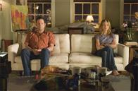 "Former lovers, now hostile roommates, bus tour guide Gary Grobowski (VINCE VAUGHN) and art dealer Brooke Meyers (JENNIFER ANISTON) ""share"" a quiet moment in the romantic comedy ""The Break-Up""."