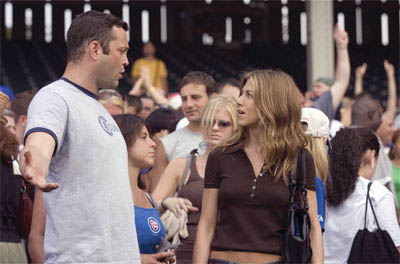 "Bus tour guide Gary Grobowski (VINCE VAUGHN) attempts to romance art dealer Brooke Meyers (JENNIFER ANISTON) at the baseball game in the romantic comedy ""The Break-Up""."