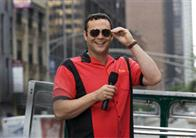 "3-Brothers Bus Tours guide Gary Grobowski (VINCE VAUGHN) keeps the crowd laughing in the romantic comedy ""The Break-Up""."