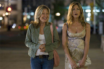 "Best friend Addie (JOEY LAUREN ADAMS) and art dealer Brooke Meyers (JENNIFER ANISTON) analyze men in the romantic comedy ""The Break-Up"".  - Large"