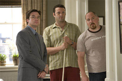 "Realtor Riggleman (JASON BATEMAN), bus tour guide Gary Grobowski (VINCE VAUGHN) and best friend Johnny O (JON FAVREAU) warily look on while Gary's ex ""cleans"" house in the romantic comedy ""The Break-Up"".  - Large"