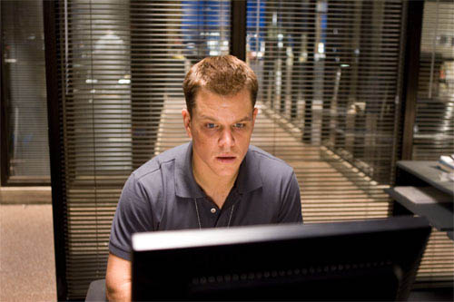 "Colin Sullivan (MATT DAMON) searches for the employment records of the undercover cop who has infiltrated Costello's gang in Warner Bros. Pictures' crime drama ""The Departed."" - Large"