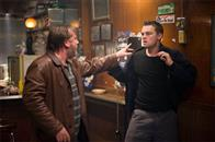 "Costello's henchman, French (RAY WINSTONE), throws Billy Costigan (LEONARDO DiCAPRIO) into a wall after a scuffle with a bar patron in Warner Bros. Pictures' crime drama ""The Departed."""