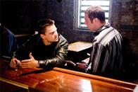 "Fitzy (DAVID O'HARA) confronts Billy Costigan (LEONARDO DiCAPRIO) after a shootout with the police leaves a fellow gang member dead in Warner Bros. Pictures' crime drama ""The Departed."""