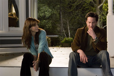 "SANDRA BULLOCK stars as Kate Forster and KEANU REEVES stars as Alex Wyler in Warner Bros. Pictures' and Village Roadshow Pictures' romantic drama ""The Lake House.""  - Large"