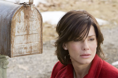 "SANDRA BULLOCK stars as Kate Forster in Warner Bros. Pictures' and Village Roadshow Pictures' romantic drama ""The Lake House,"" also starring Keanu Reeves. - Large"