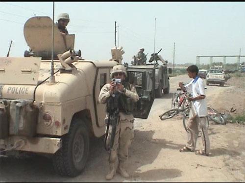 Sergeant Steve Pink filming. - Large