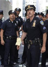 In <i>World Trade Center</i>, Academy Award®-winning director Oliver Stone tells the true story of the heroic survival and rescue of two Port Authority policemen - John McLoughlin (Nicolas Cage, right) and Will Jimeno (Michael Peña, left) - who were trapped in the rubble of the World Trade Center on September 11, 2001, after they went in to help people escape.