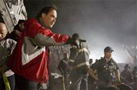 In <i>World Trade Center</i>, Academy Award®-winning director Oliver Stone (pictured) tells the true story of the heroic survival and rescue of two Port Authority policemen - John McLoughlin and Will Jimeno - who were trapped in the rubble of the World Trade Center on September 11, 2001, after they went in to help people escape.