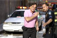 In <i>World Trade Center</i>, Academy Award®-winning director Oliver Stone (left) tells the true story of the heroic survival and rescue of two Port Authority policemen - John McLoughlin and Will Jimeno - who were trapped in the rubble of the World Trade Center on September 11, 2001, after they went in to help people escape.  Stone discusses a scene with Nicolas Cage (right), who plays McLoughlin.