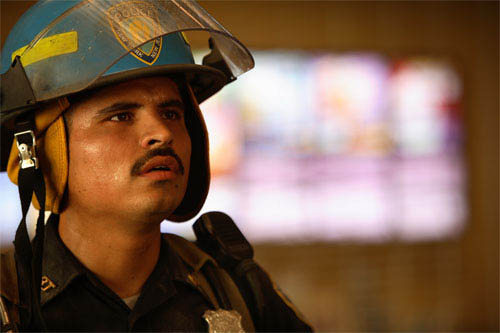 In <i>World Trade Center</i>,  Academy Award®-winning director Oliver Stone tells the true story of the heroic survival and rescue of two Port Authority policemen - John McLoughlin and Will Jimeno (Michael Peña, pictured) - who were trapped in the rubble of the World Trade Center on September 11, 2001, after they went in to help people escape. - Large