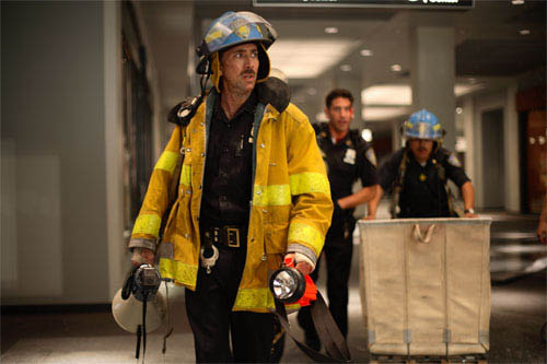 In <i>World Trade Center</i>, Academy Award®-winning director Oliver Stone tells the true story of the heroic survival and rescue of two Port Authority policemen - John McLoughlin (Nicolas Cage, pictured) and Will Jimeno - who were trapped in the rubble of the World Trade Center on September 11, 2001, after they went in to help people escape. - Large