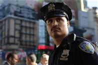 In <i>World Trade Center</i>, Academy Award®-winning director Oliver Stone tells the true story of the heroic survival and rescue of two Port Authority policemen - John McLoughlin and Will Jimeno (Michael Peña, pictured) - who were trapped in the rubble of the World Trade Center on September 11, 2001, after they went in to help people escape.