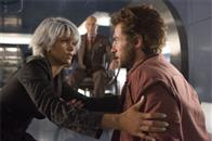 Storm (Halle Berry) enlists Wolverine's (Hugh Jackman) help, as Xavier (Patrick Stewart) looks on.
