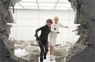 Kitty Pryde (Ellen Page) and Leech (Cameron Bright) make a hasty escape in the midst of an epic battle.