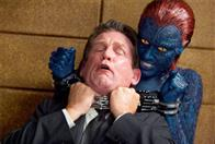 Mystique (Rebecca Romijn) chokes an FBI agent (Anthony Heald).
