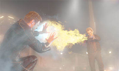 Iceman (Shawn Ashmore) radiates intense cold to ward off Pyro's (Aaron Stanford) fiery attack.  - Large