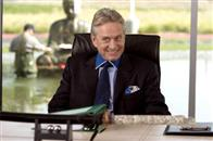 "Mr. Thompson (MICHAEL DOUGLAS) plots and schemes in the comedy ""You, Me and Dupree""."