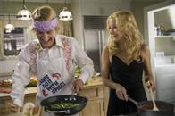 "Molly (KATE HUDSON) and her permanent houseguest Dupree (OWEN WILSON) start supper in the comedy ""You, Me and Dupree""."