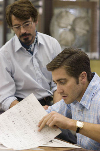 "Paul Avery (ROBERT DOWNEY JR., left) and Robert Graysmith (JAKE GYLLENHAAL, right) are newspapermen who pour over the clues and symbols left by a serial killer in Paramount Pictures and Warner Bros. Pictures' thriller ""Zodiac.""  - Large"
