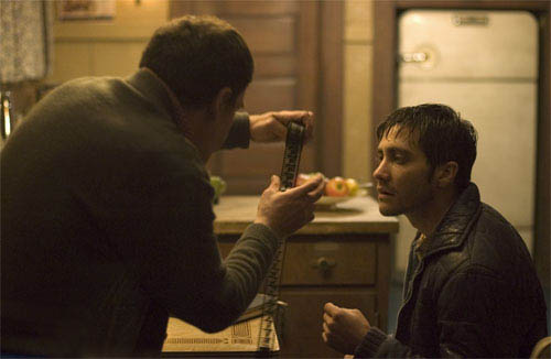 """Robert Graysmith (JAKE GYLLENHAAL, right) looks over some evidence on the trail of a serial killer in Paramount Pictures and Warner Bros. Pictures' thriller """"Zodiac."""" - Large"""