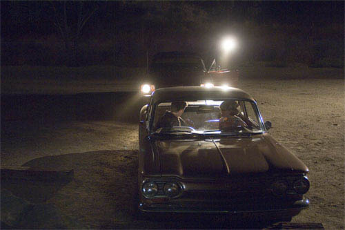 """A young couple in a car is stalked by a serial killer in Paramount Pictures and Warner Bros. Pictures' thriller """"Zodiac.""""  - Large"""