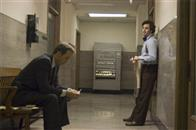 "Inspector Bill Armstrong (ANTHONY EDWARDS, left) sits down to talk with Inspector Dave Toschi (MARK RUFFALO) about a serial killer in Paramount Pictures and Warner Bros. Pictures' thriller ""Zodiac."""